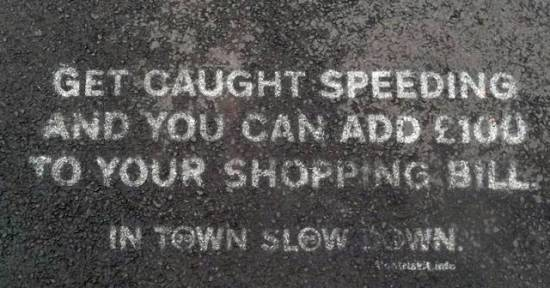 In Town Slow Down Footpath Sign